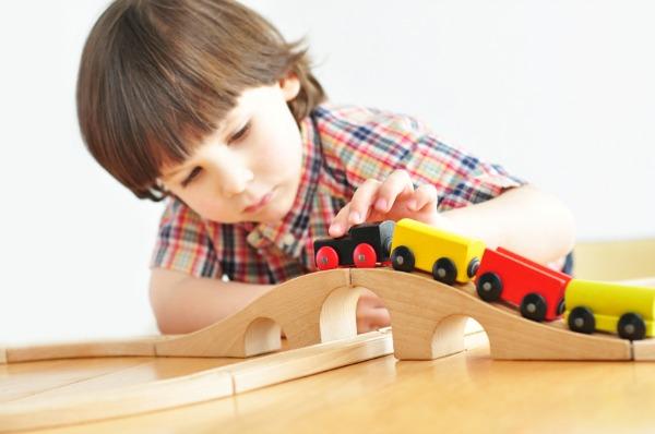 preschool-boy-playing-with-train